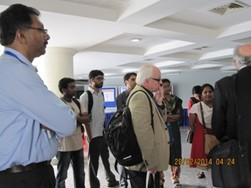 UK researchers interacting with young faculty/researchers at a poster session at NIHMANS